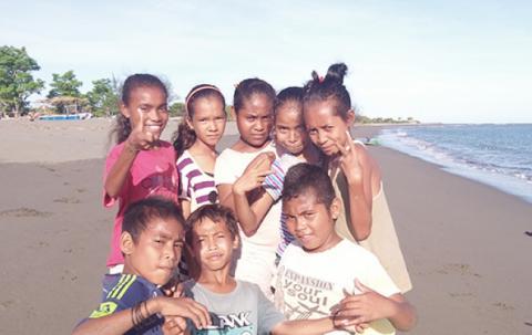 Children pose for the camera.