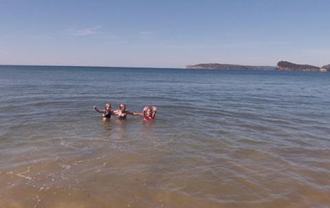 Jess swimming at the beach